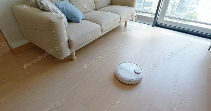 Robotic vacuum cleaner slides across the room
