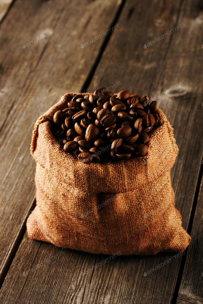 Coffee beans in bag on table