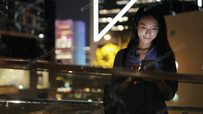 Woman watching on cellphone