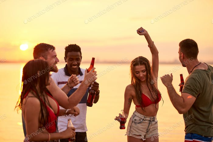 Cheerful young friends enjoying vacation at sea