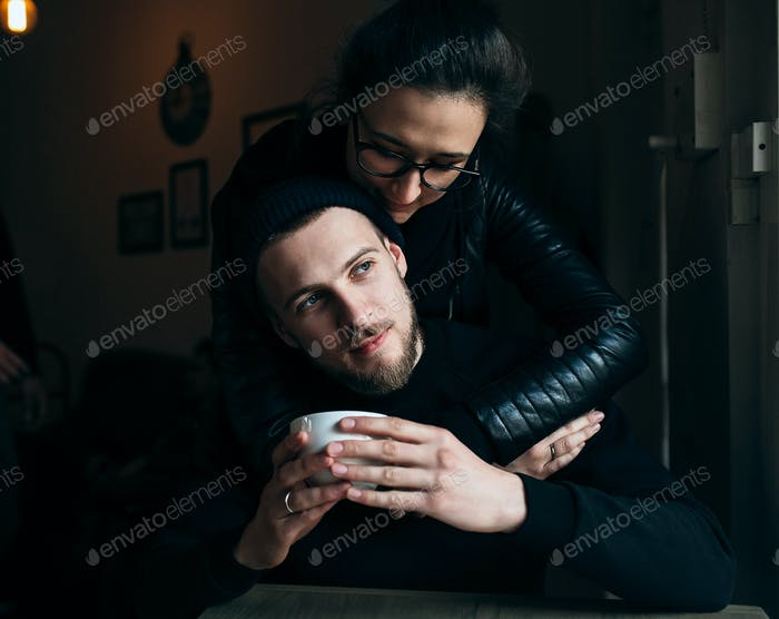 young man and woman posing indoors
