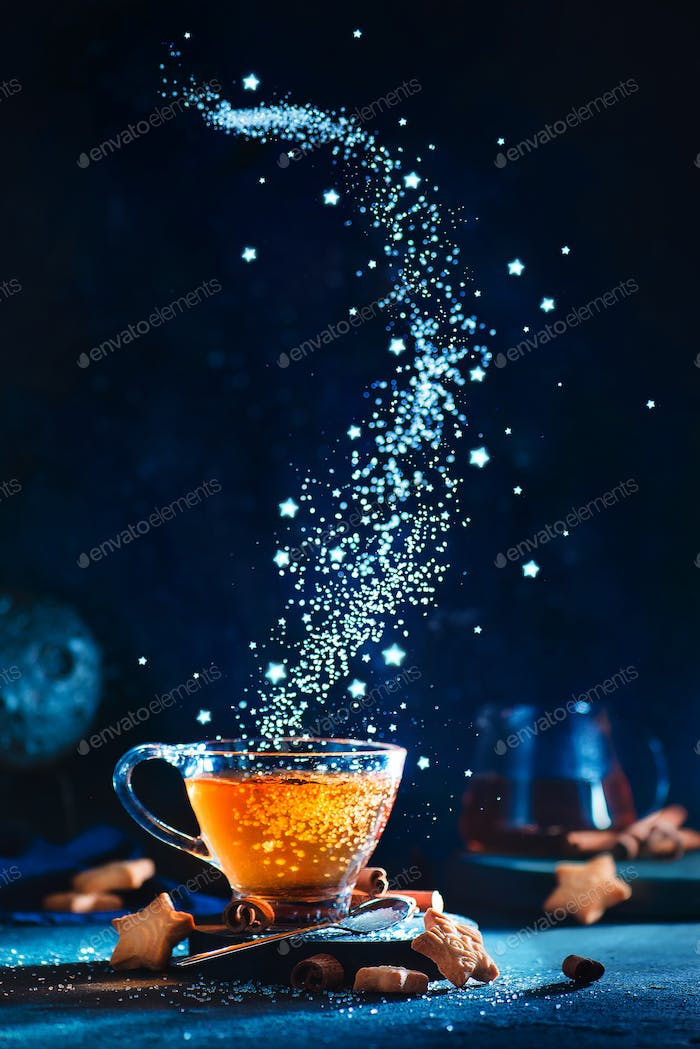 Sugar nebula creative food photo. Teacup with falling sugar forming Milky Way galaxy. Conceptual