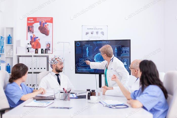 Female neurologist reading brain waves