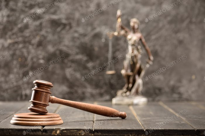 Close-up view of brown mallet of judge on wooden table, law concept