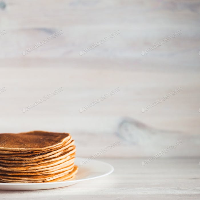 Delicious pancakes on wooden background