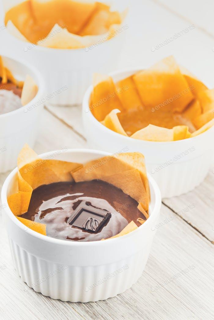 Chocolate mass for fondant in the ramekin vertical