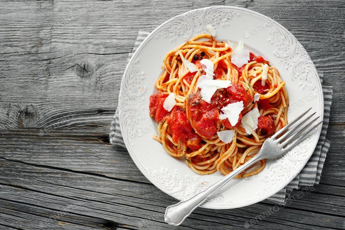 Tomato pasta with cheese on plate