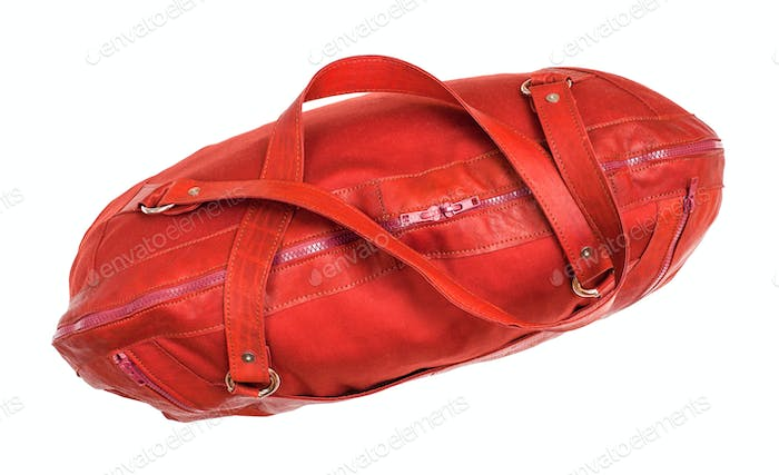 top view of closed red travelling bag isolated