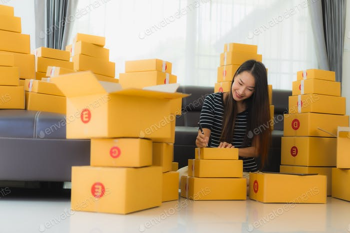 Portrait beautiful young asian woman with container cardboard parcel box