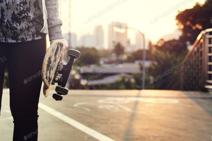 Skater Boy Holding Skateboard Outdoors Concept