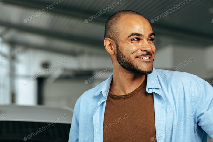 Smiling african american man smiling and looking to side
