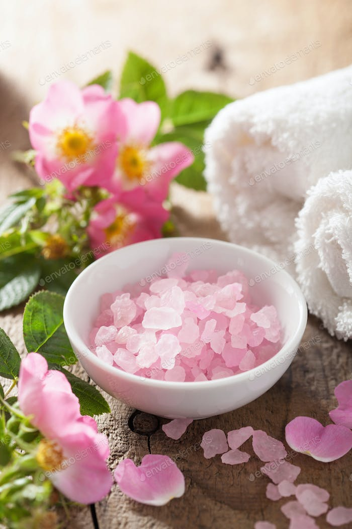 spa with pink herbal salt and wild rose flowers