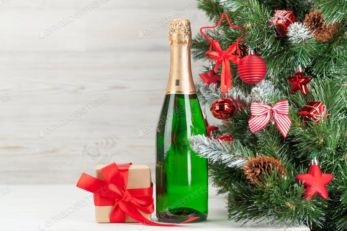 Christmas card with fir tree, champagne and gift