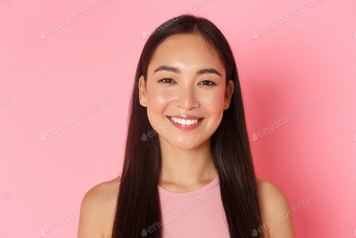 Beauty, fashion and lifestyle concept. Close-up of beautiful happy asian girl with perfect white