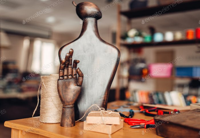 Needlework accessories, wooden hand and mannequin