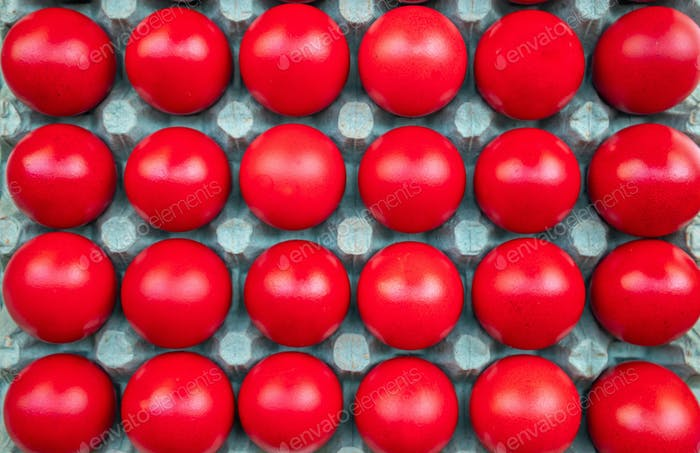 Easter eggs, red color background. Top view