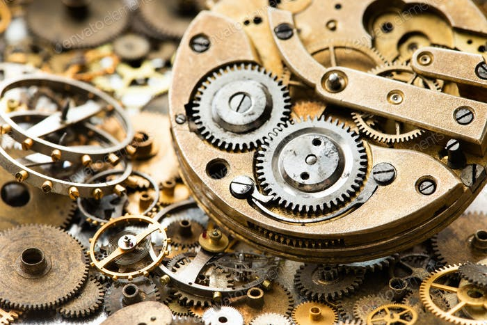 Vintage pocket watch clockwork mechanism parts and hand watch macro view