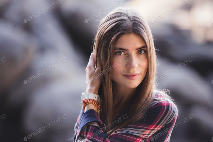 Close-up portrait of a beautiful hipster girl at sunset