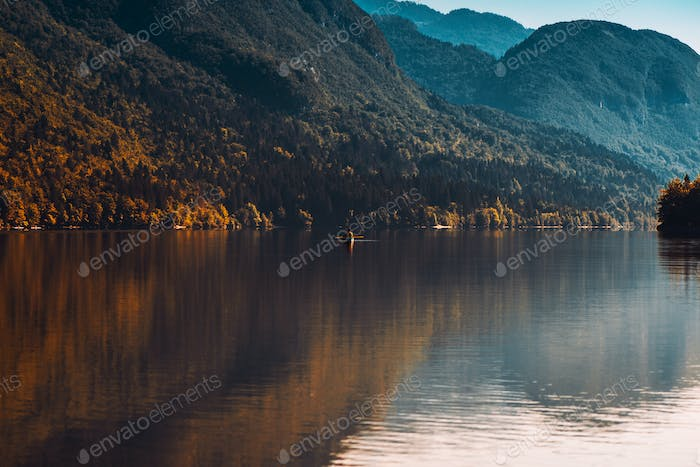 Man rowing boat on Lake Bohinj
