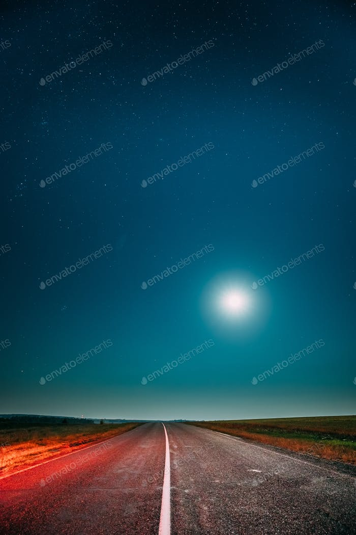 Night Starry Sky With Moon Above Country Asphalt Road In Country