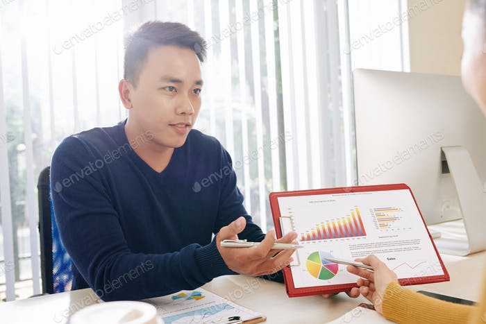Businessman showing chart and circle diagram