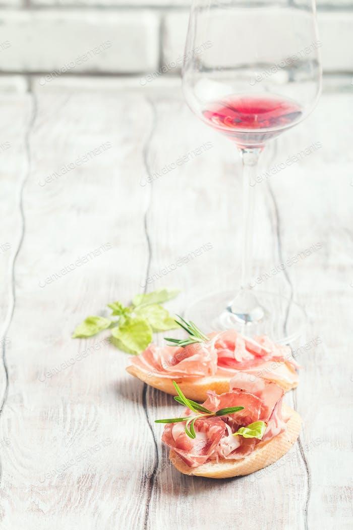 red wine and bruschetta with prosciutto