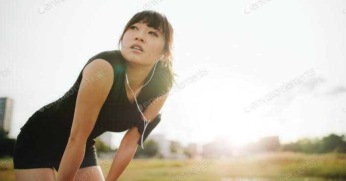 Young athletic woman taking a break from training
