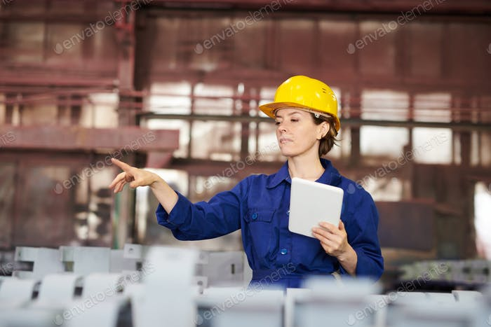 Female Worker Managing Production