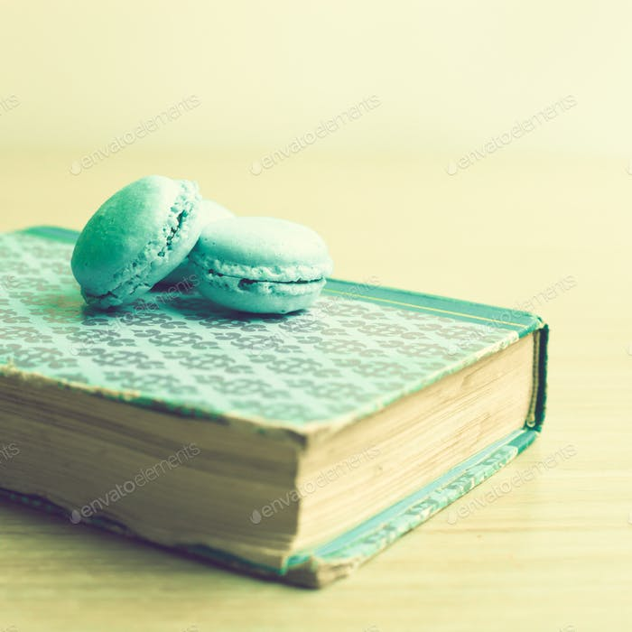 Turquoise macaroons in a book