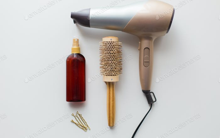 hairdryer, brush, hot styling hair spray and pins
