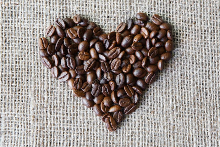 Burlap texture with coffee beans heart shape
