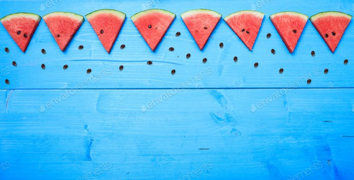 Watermelon pieces on a blue board