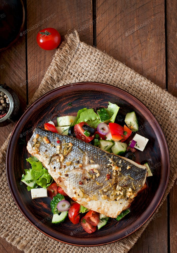Baked seabass with Greek salad