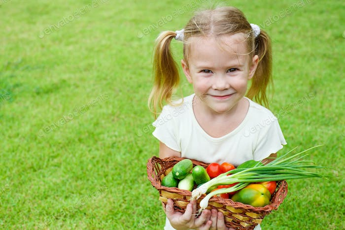 girl holding a basket of vegetables
