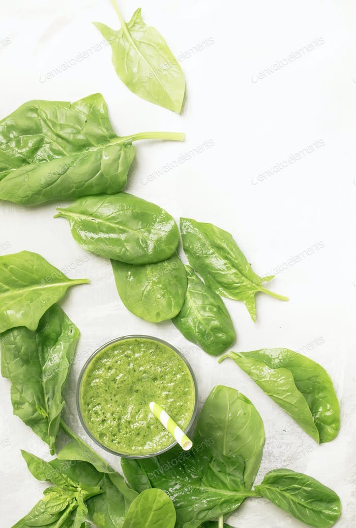 Spinach avocado smoothie and green leaves, drink background, healthy eating and raw diet