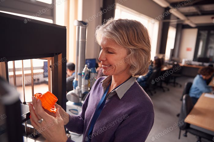 Mature Female College Student Studying Engineering Using 3D Printing Machine