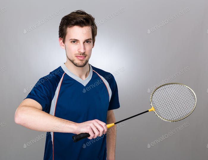 Sport man play with badminton