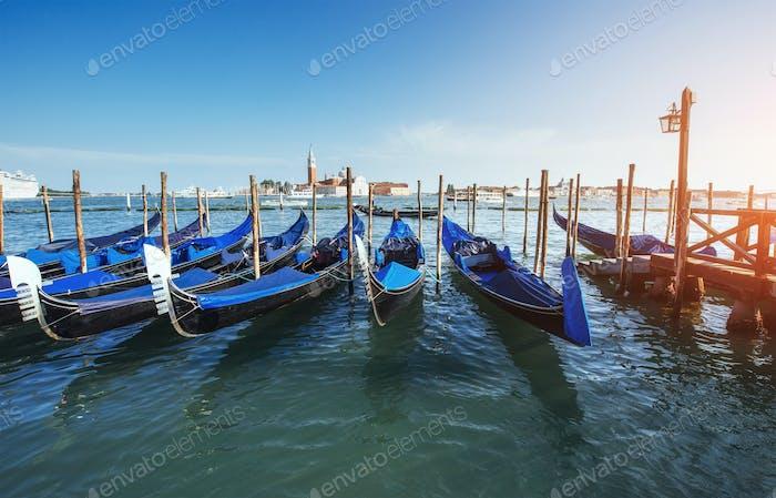 Gondolas on Grand canal in Venice, San Giorgio Maggiore church. San Marco.