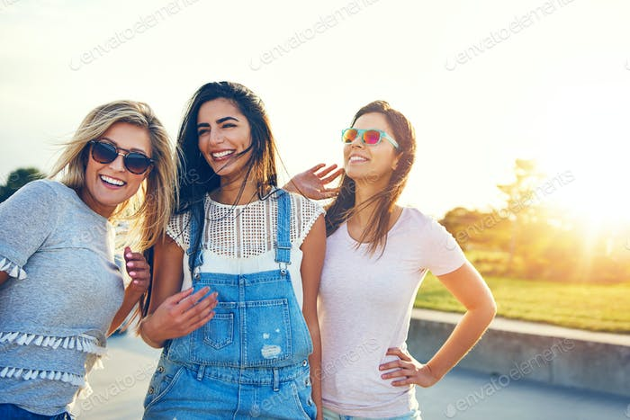 Three multiracial women friends at the seaside