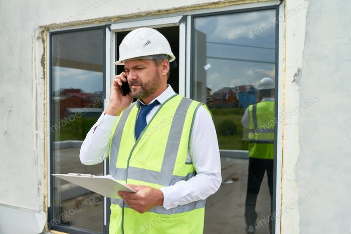 Construction Supervisor Speaking by Phone