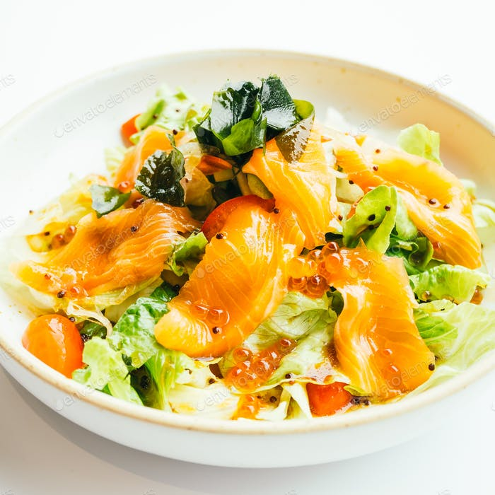 Raw fresh salmon meat sashimi with vegetable salad