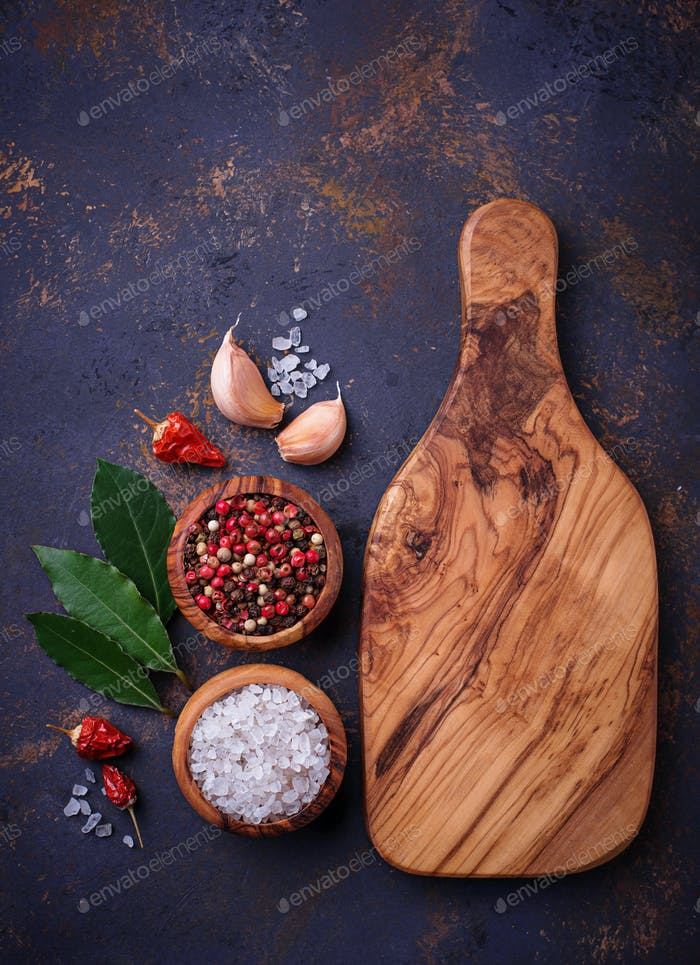 Cutting board with herbs and spices.