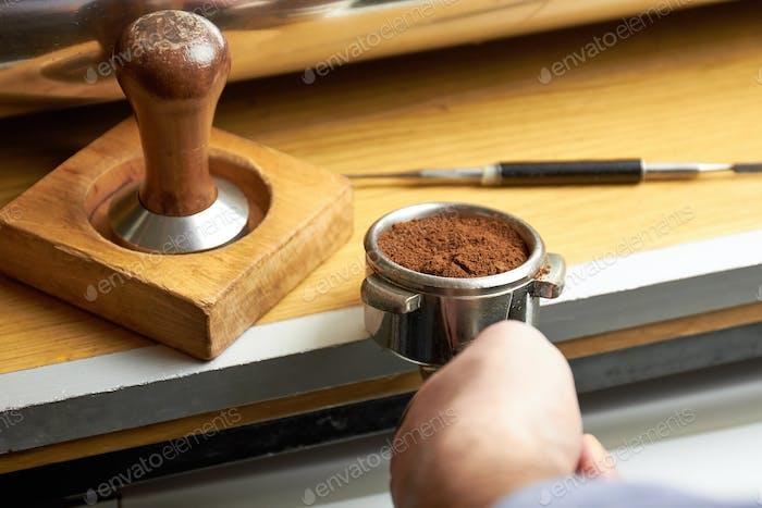 Portafilter with ground coffee