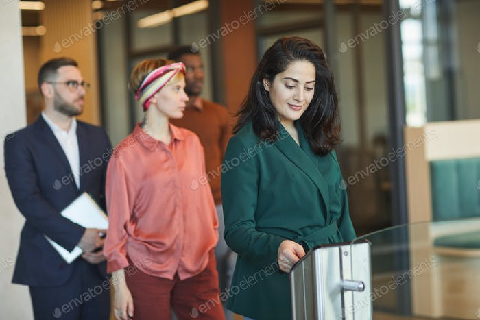 Business People Entering Automated Gate