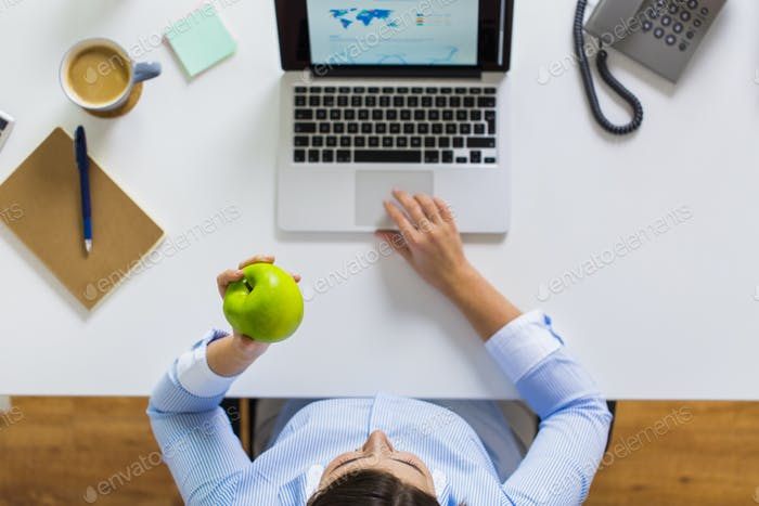 businesswoman with apple and laptop at office