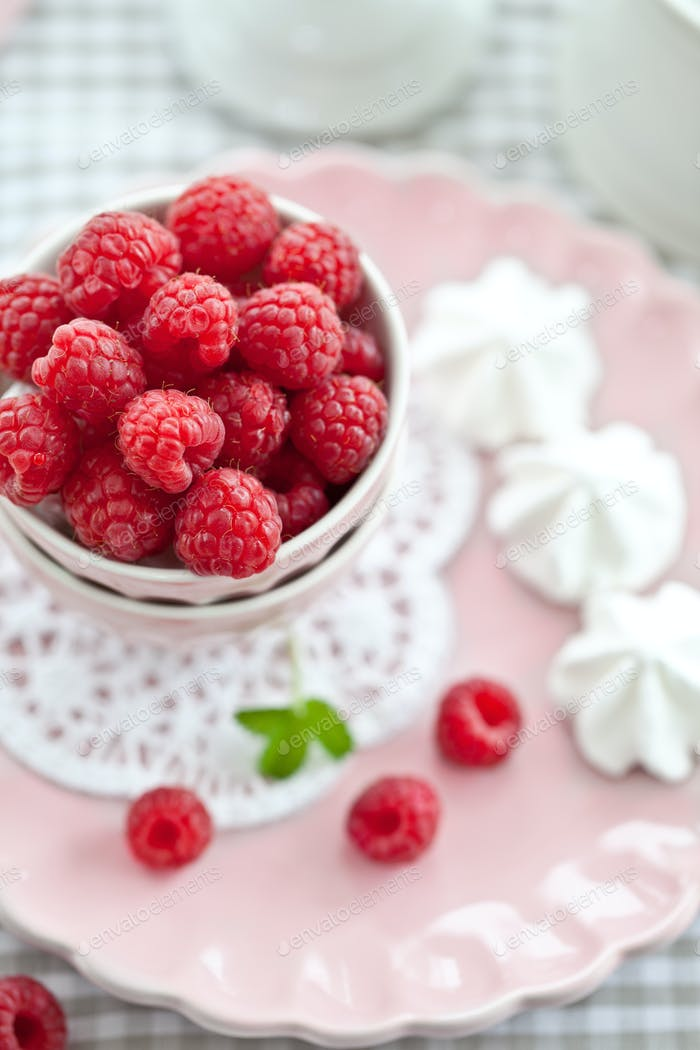 Fresh raspberries on a pink plate