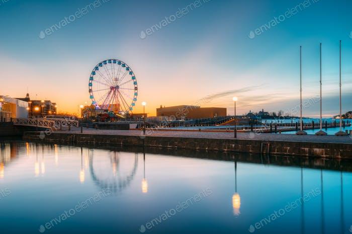 Helsinki, Finland. View Of Embankment With Ferris Wheel In Sunri
