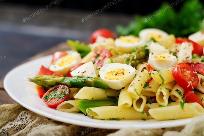 Salad - penne pasta with asparagus, tomatoes, quail eggs, mozzarella