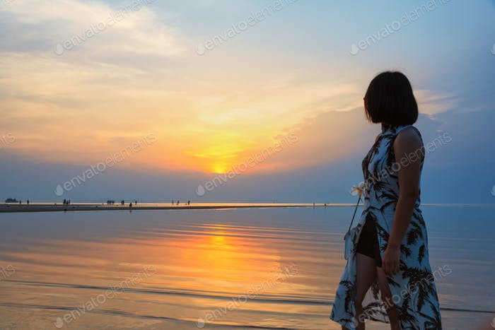 Woman watching Sunset at the beach
