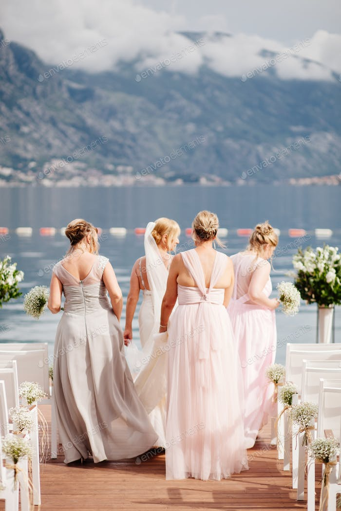 bride with bridesmaids at wedding in mountains